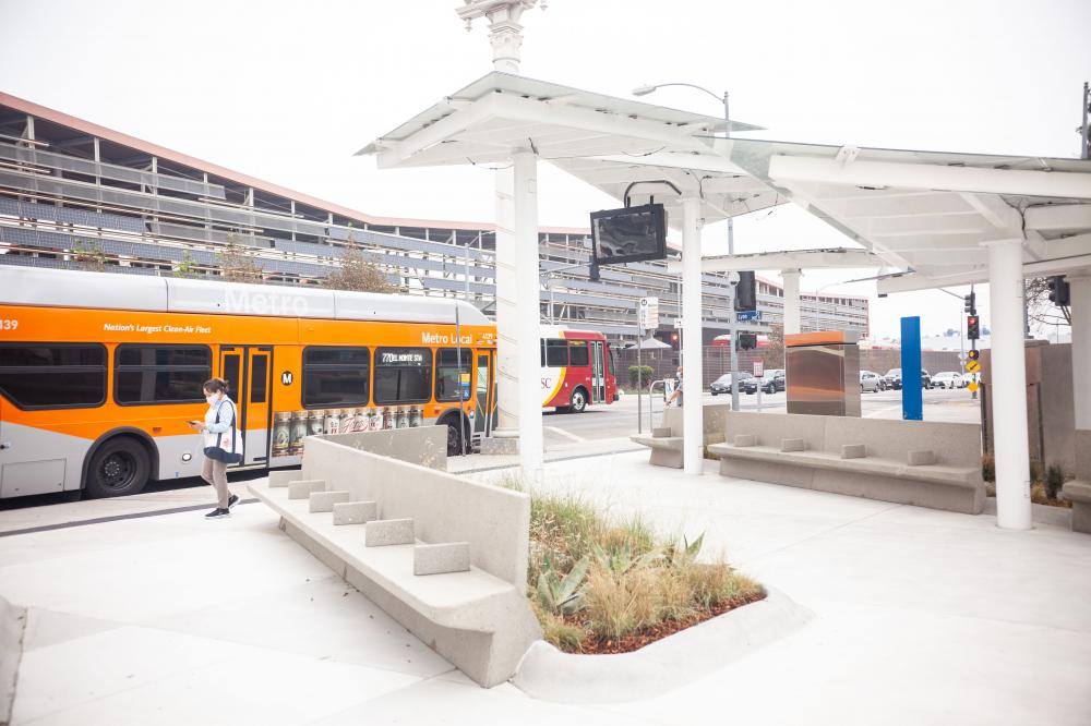 Chavez Bus Stop Improvements Project with patron leaving Metro Local Bus.